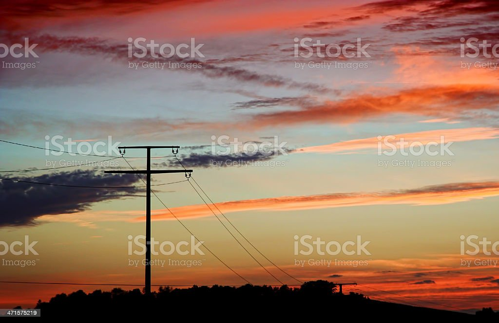 Electricity pylon in a rural sunset landscape royalty-free stock photo