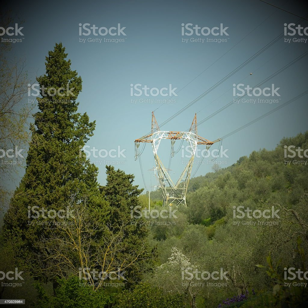 Electricity pylon in natural landscape stock photo