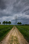Electricity pylon in the field, Germany