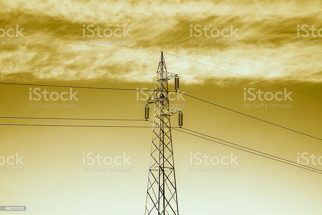 Electricity pylon on golden background stock photo