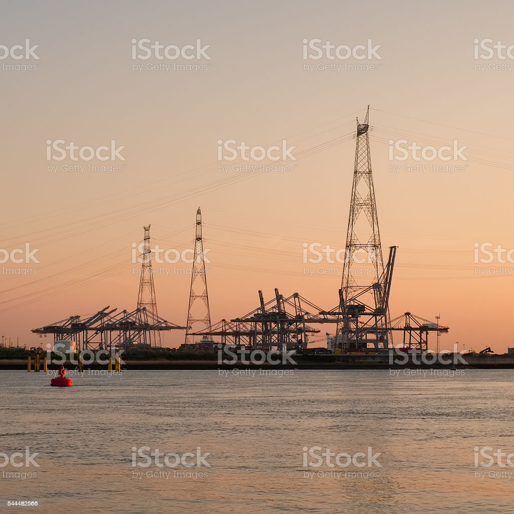 Electricity pylon silhouette against sunset stock photo