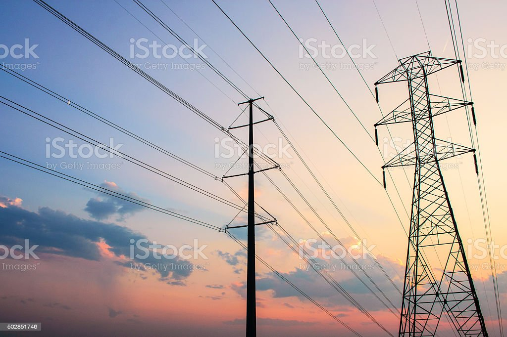 Electricity Pylon Silhouettes at Sunset stock photo