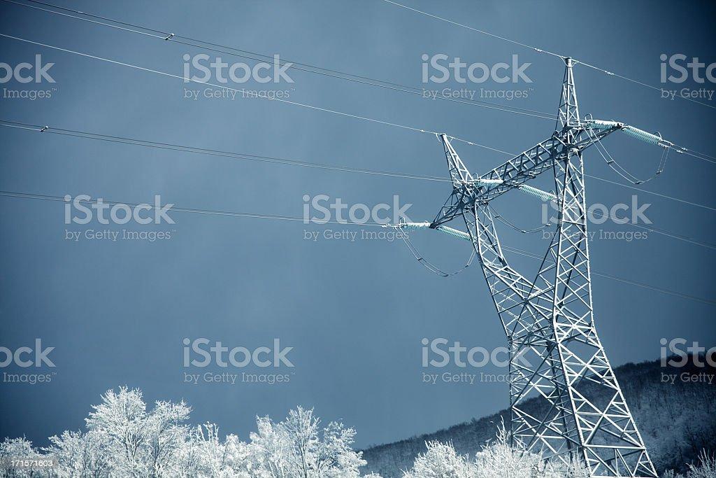 Electricity pylon winter shot stock photo