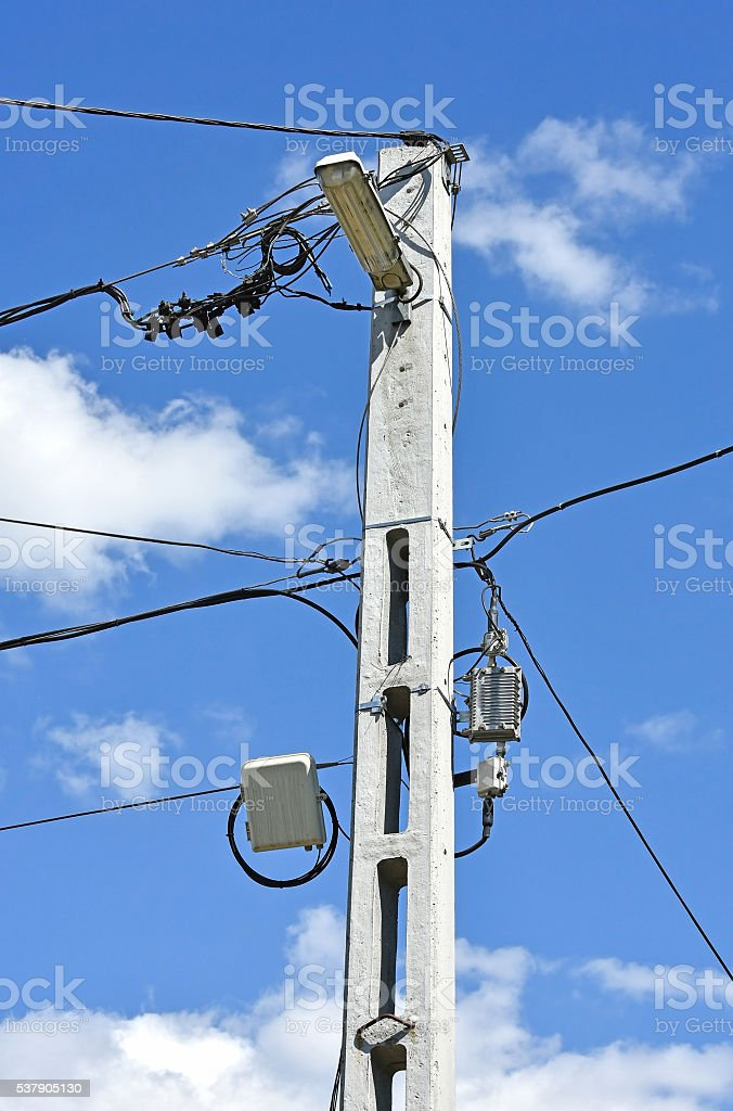 Electricity pylon with street light stock photo