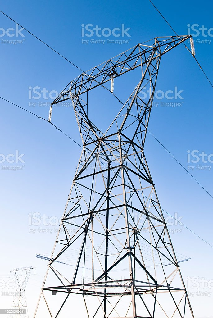 Electricity Pylons Against Clear Sky royalty-free stock photo