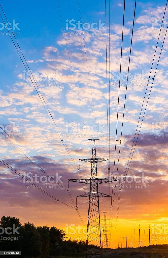 electricity pylons and lines at dusk stock photo