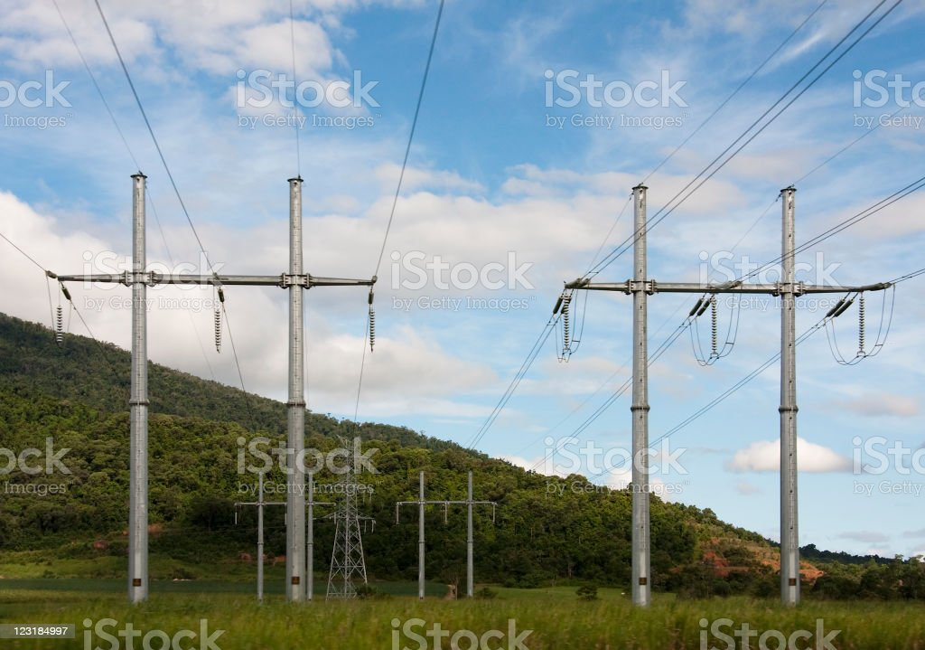 Electricity Pylons in Field supplying power to consumers royalty-free stock photo