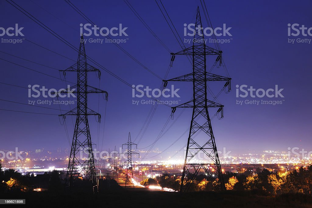 Electricity Pylons in Illuminated Quebec City stock photo