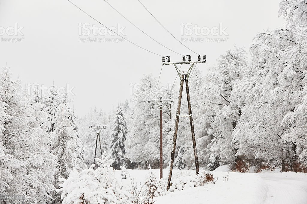 Electricity pylons in winter stock photo