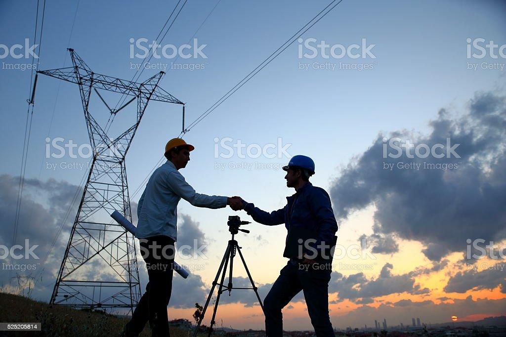 Electricity station handshake stock photo