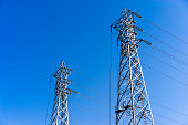 Electricity tower against blue sky