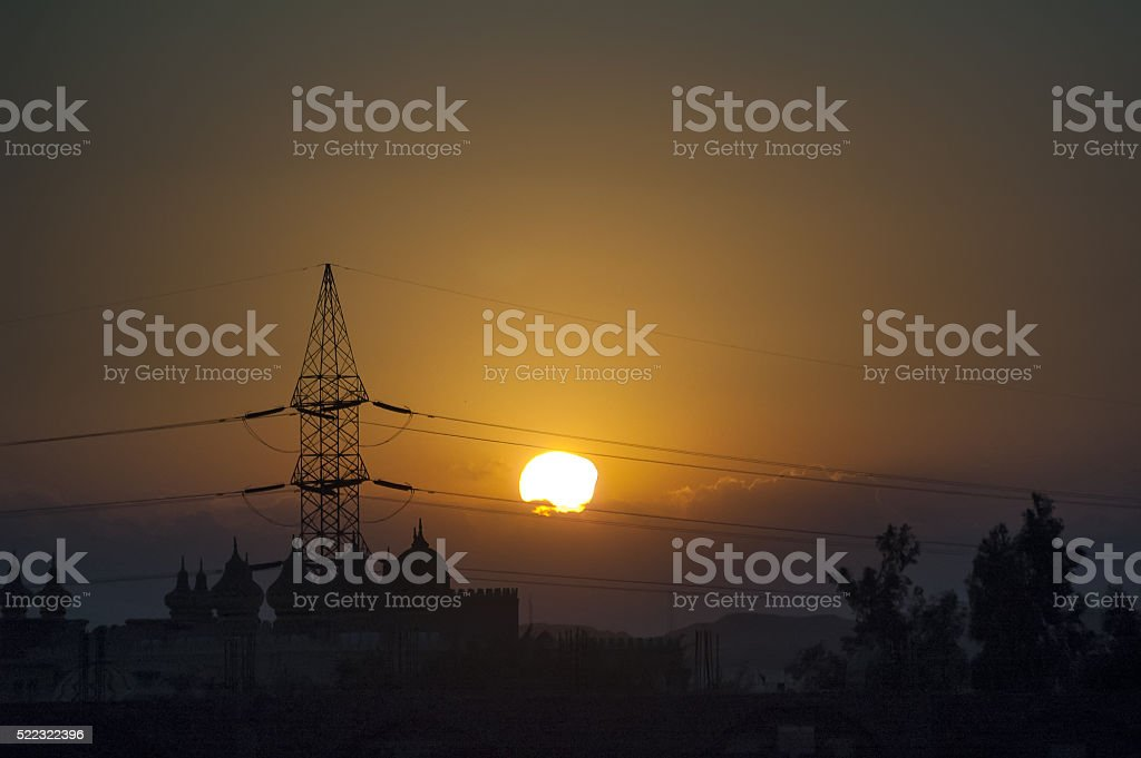 Electricity tower in desert of Egypt at dusk stock photo