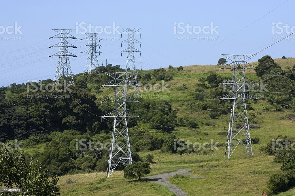 Electricity towers across hills royalty-free stock photo