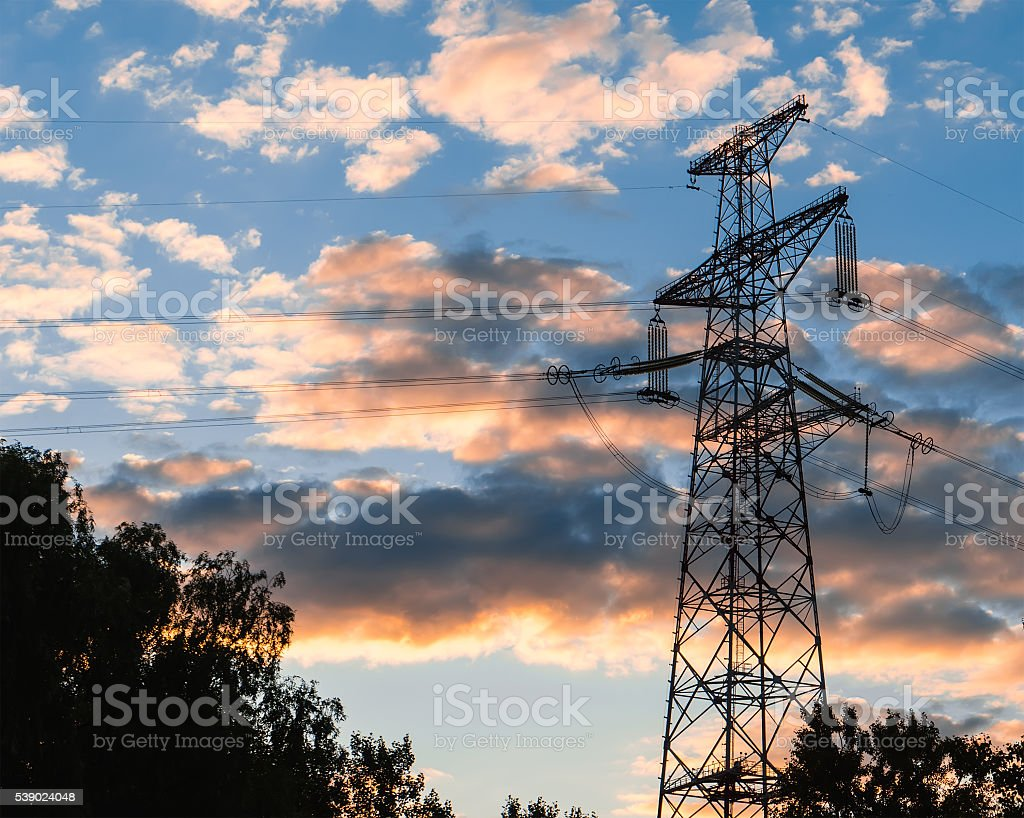 electricity transmission pylon at city suburb against the stock photo