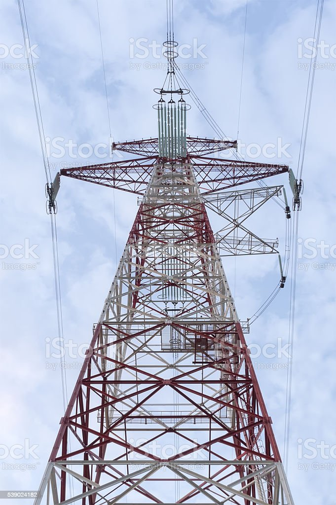 electricity transmission pylon at city suburb against the sunset stock photo