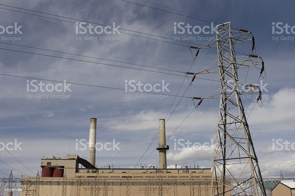 Electricity transmission tower and power plant royalty-free stock photo