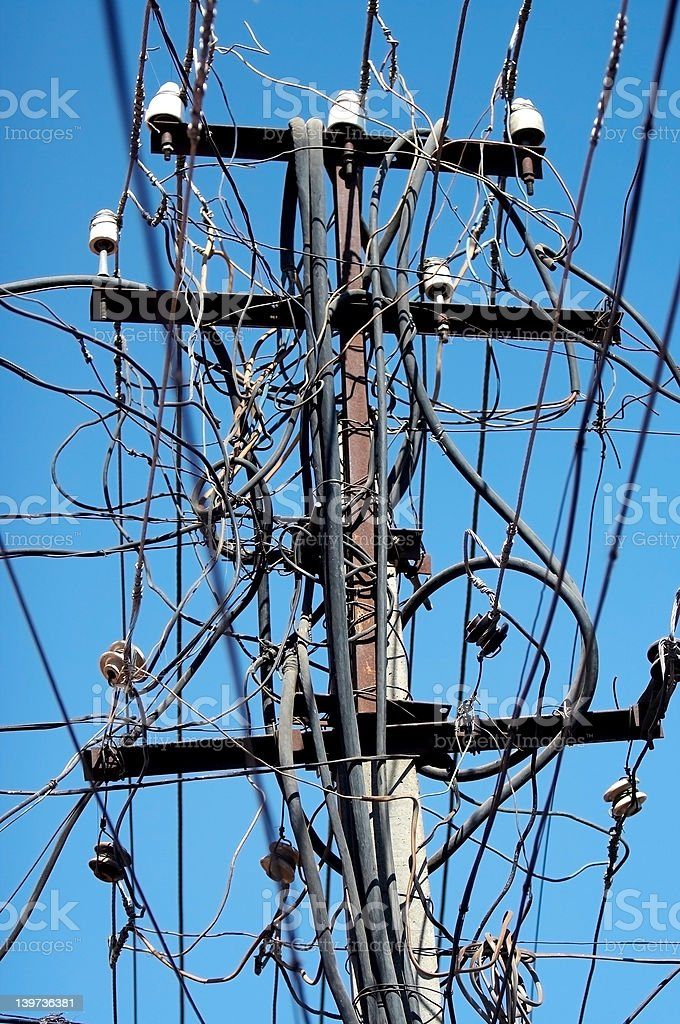 Electricity Transmission Tower - Chaotic Electric Wiring royalty-free stock photo
