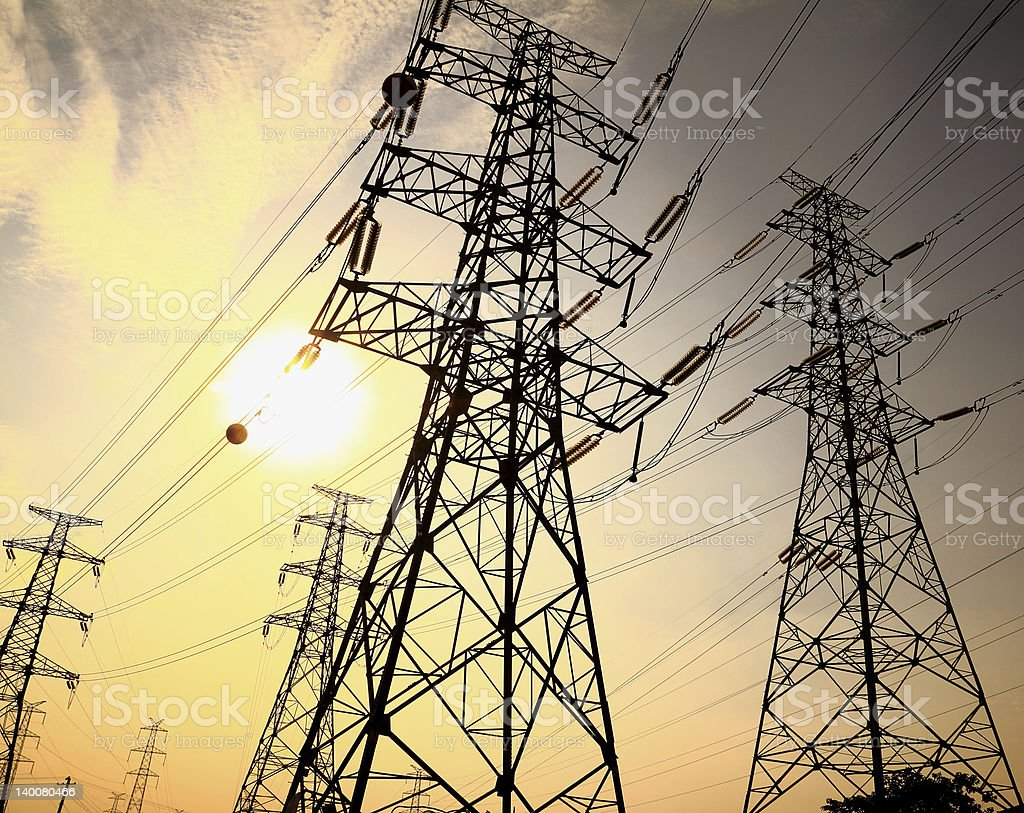 Electricity transmission towers and wires in sunlight royalty-free stock photo