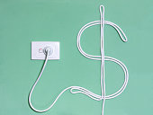 Electricity wall socket and power cord in the dollar sign