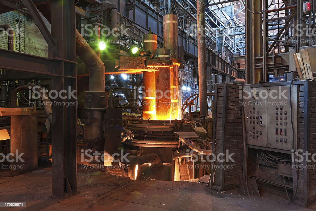 Electroarc furnace at the metallurgical plant stock photo