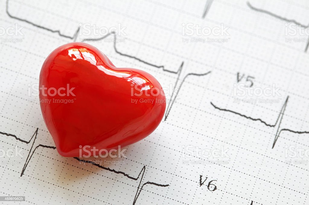 Electrocardiograph and heart shape object stock photo