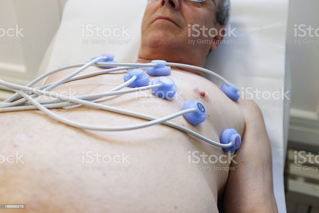 Electrocardiography...senior at the doctor,nurse is recording ECG royalty-free stock photo