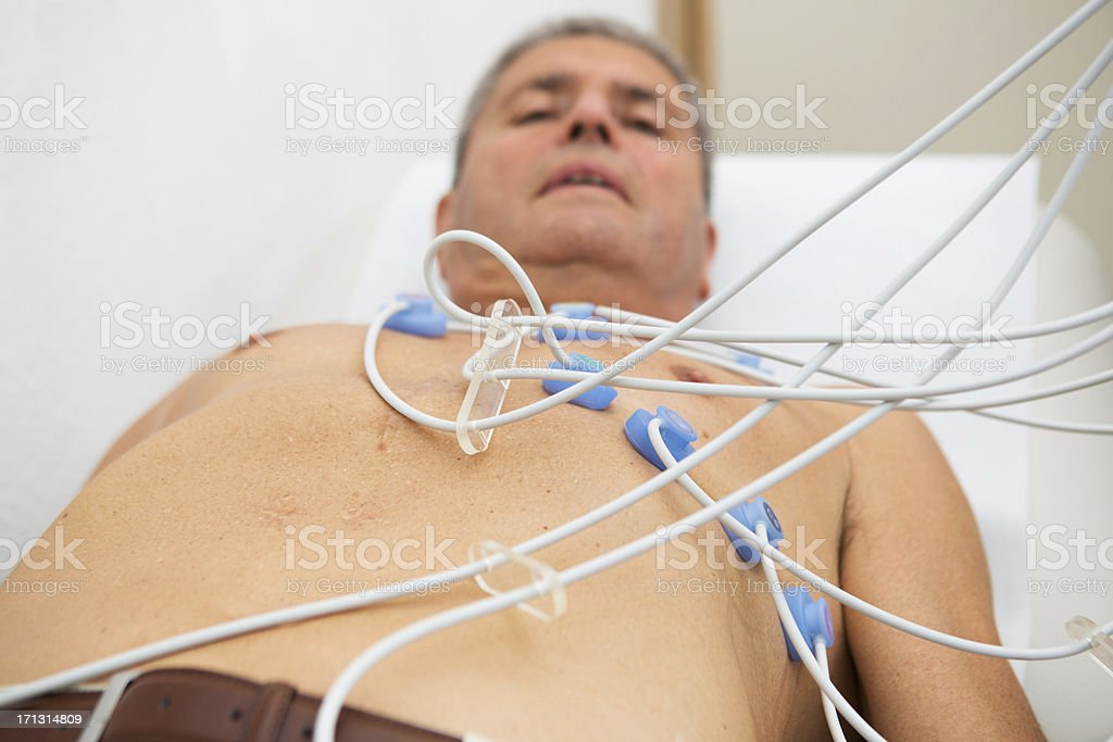 Electrocardiography...senior gentleman checking his ECG royalty-free stock photo