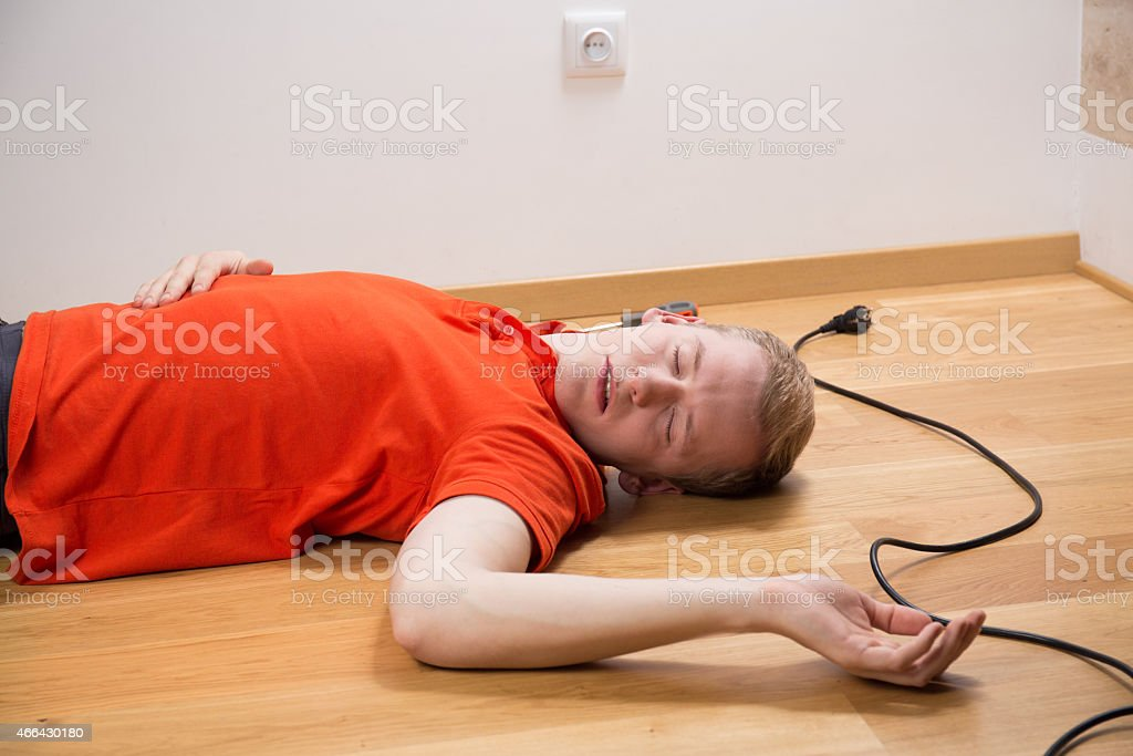 Electrocuted electrician lying stock photo