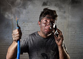 electrocuted man calling for help in dirty burnt funny face