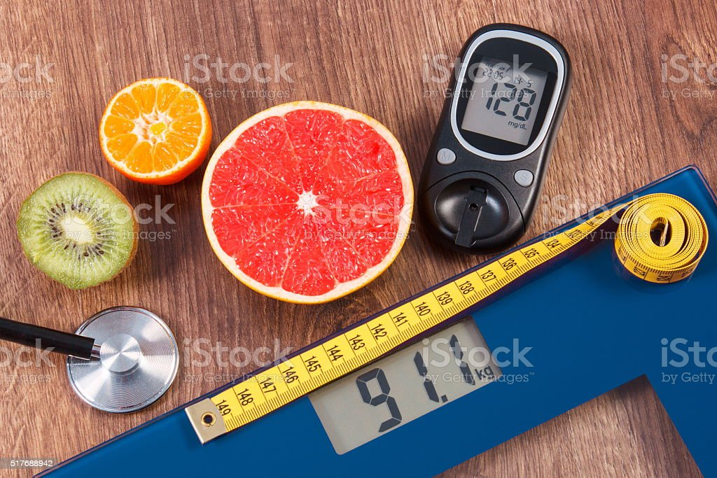 Electronic bathroom scale and glucometer with result, centimeter, stethoscope stock photo