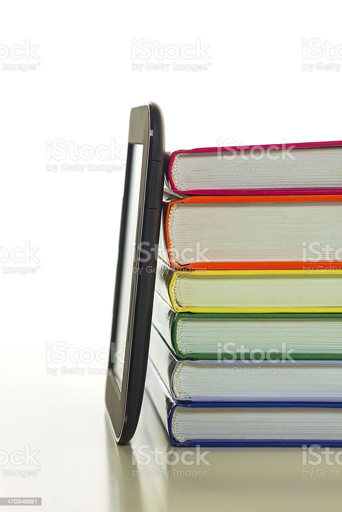 Electronic book reader with hard cover books stock photo