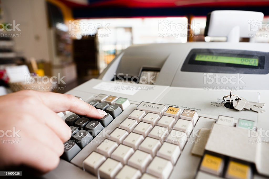 Electronic cash register in operation royalty-free stock photo