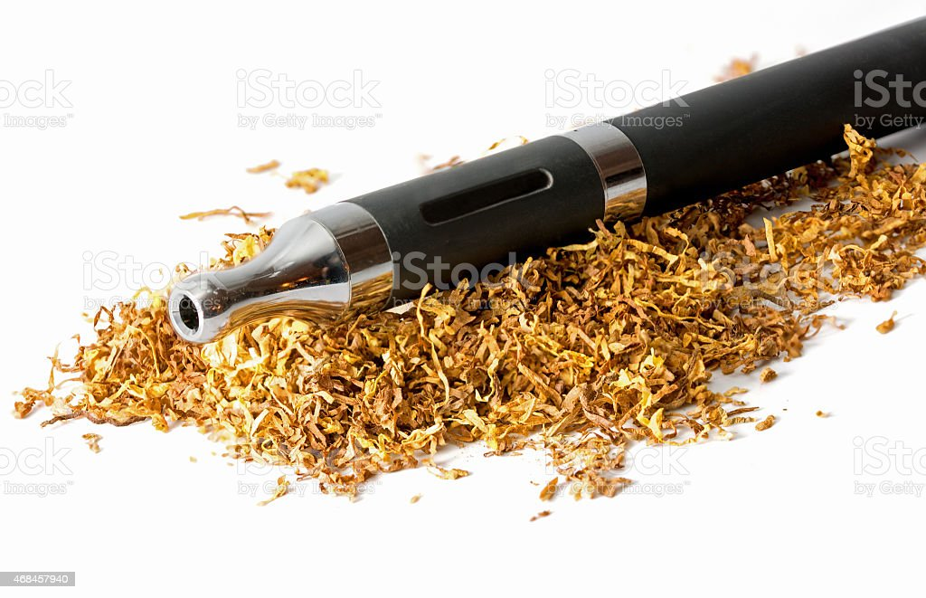 electronic cigarette in loose tobacco isolated on white stock photo