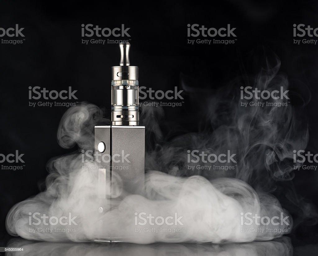 electronic cigarette over a dark background stock photo