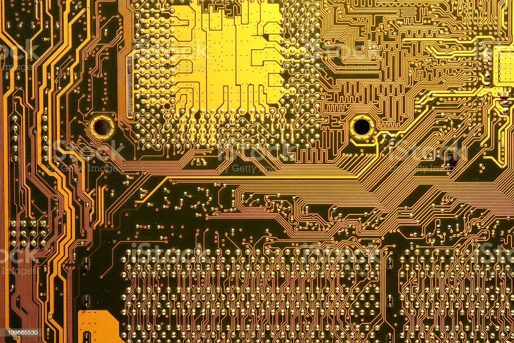 Electronic circuit board close-up with golden connections royalty-free stock photo