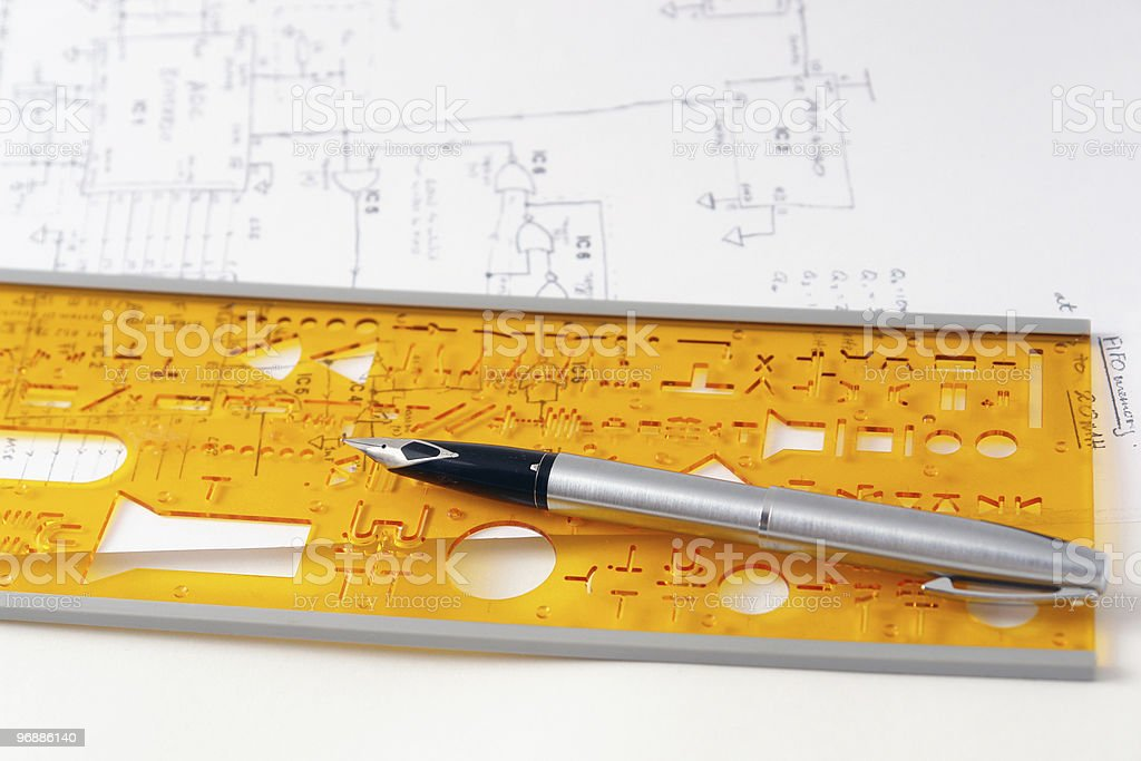 Electronic circuit diagram and a drawing stencil with pen royalty-free stock photo