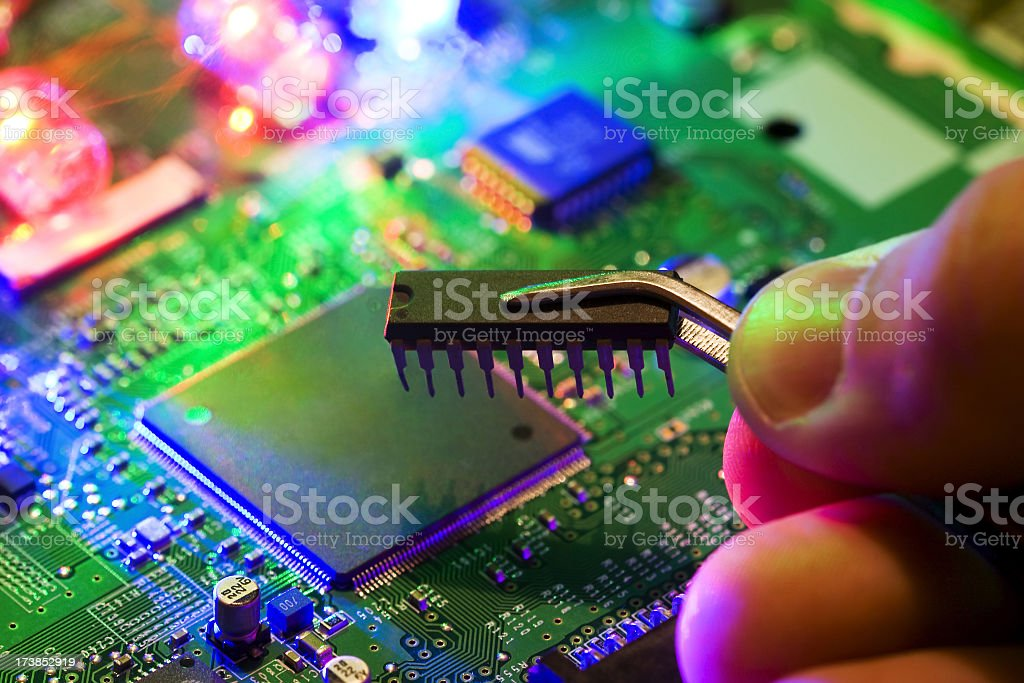 Electronic circuits in the light of the laser. stock photo