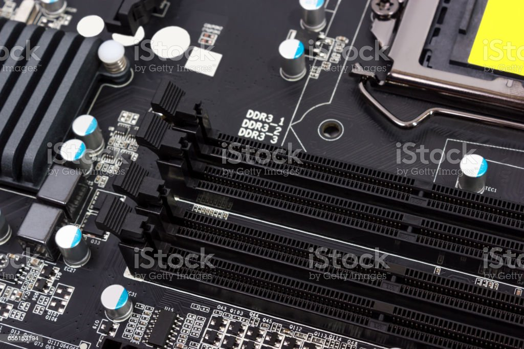 Electronic collection - digital components on computer motherboard with RAM connector stock photo