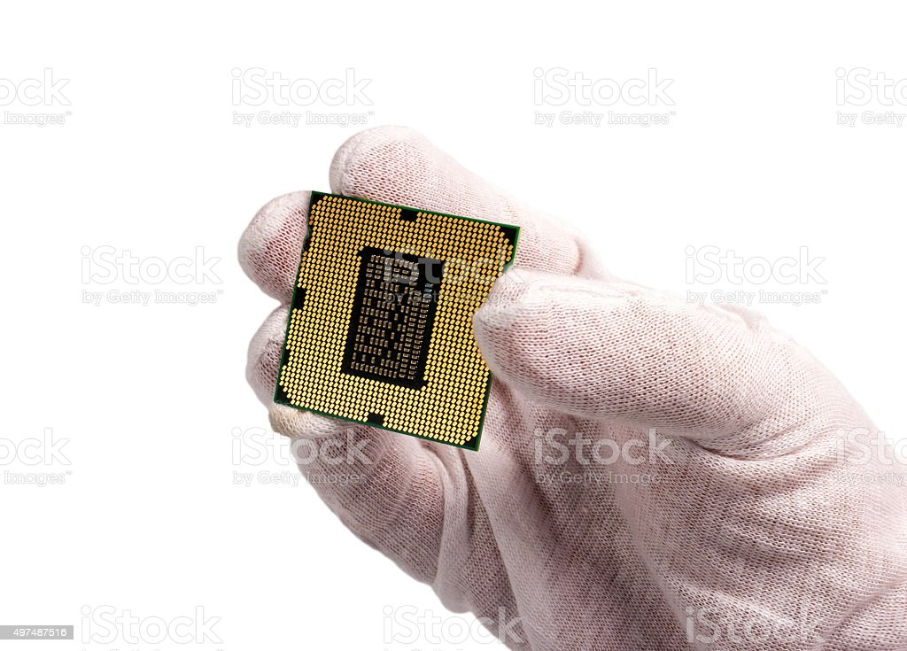 Electronic collection - Hand and CPU isolated on white background stock photo