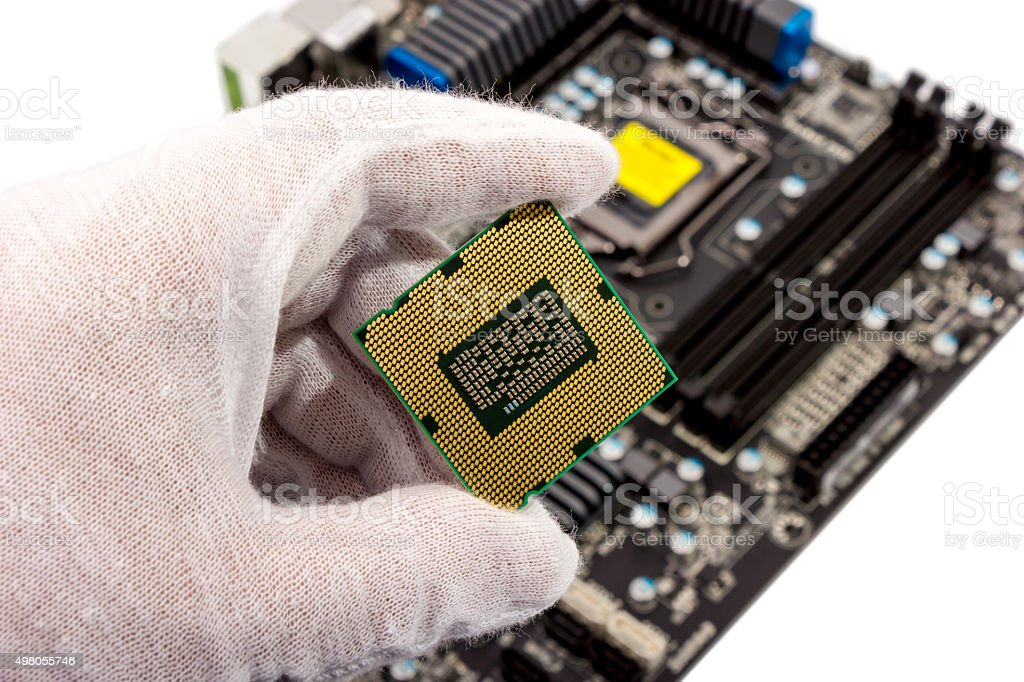 Electronic collection - Installing CPU in motherboard stock photo