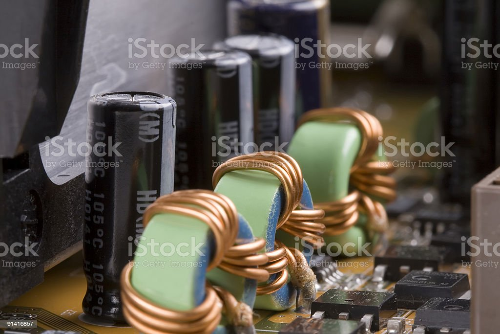Electronic components computer motherboard capacitors stock photo