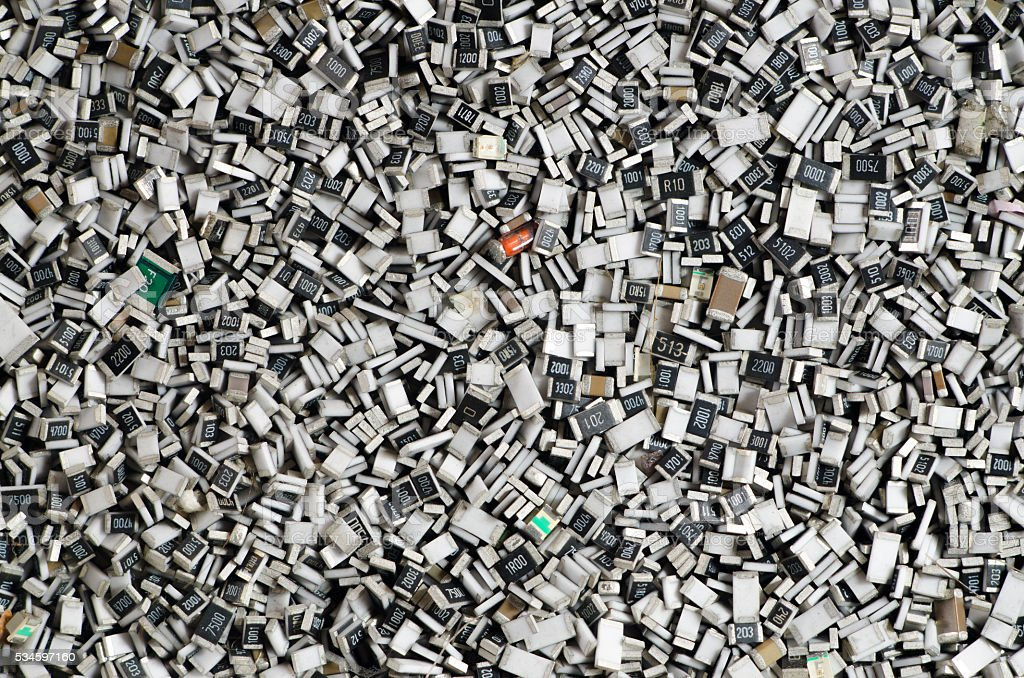 Electronic components in bulk. Texture of chip resistors stock photo