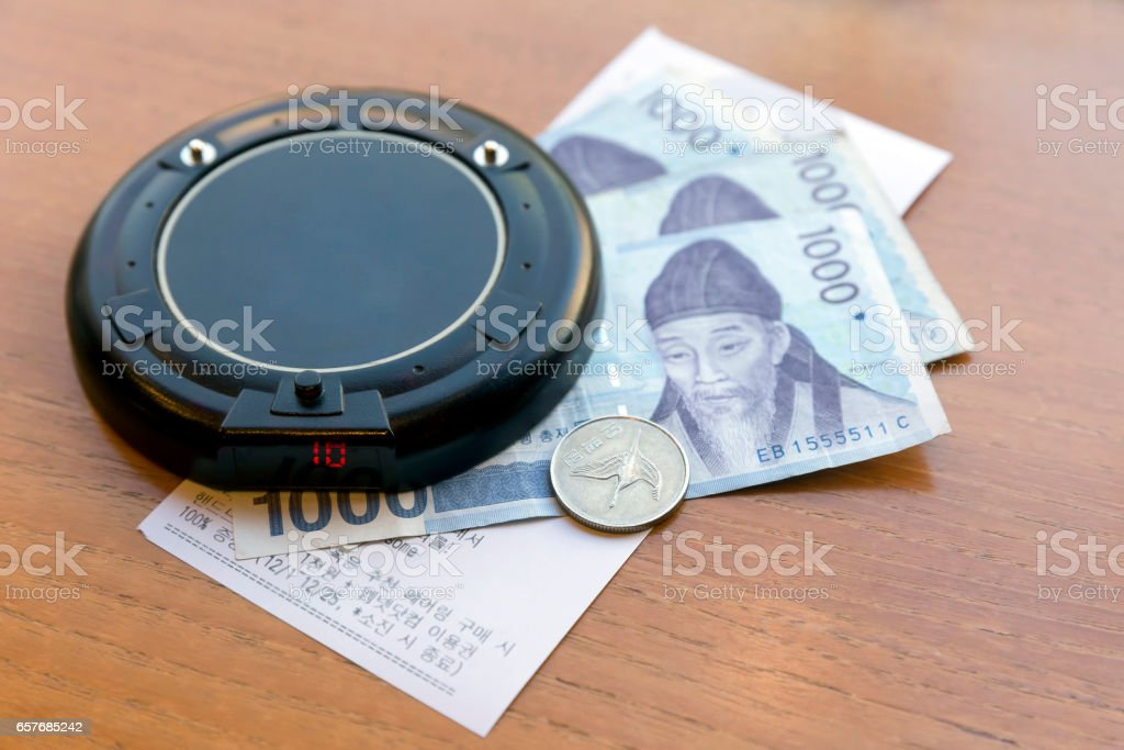 Electronic customer calling card on Korean money and payment bill stock photo
