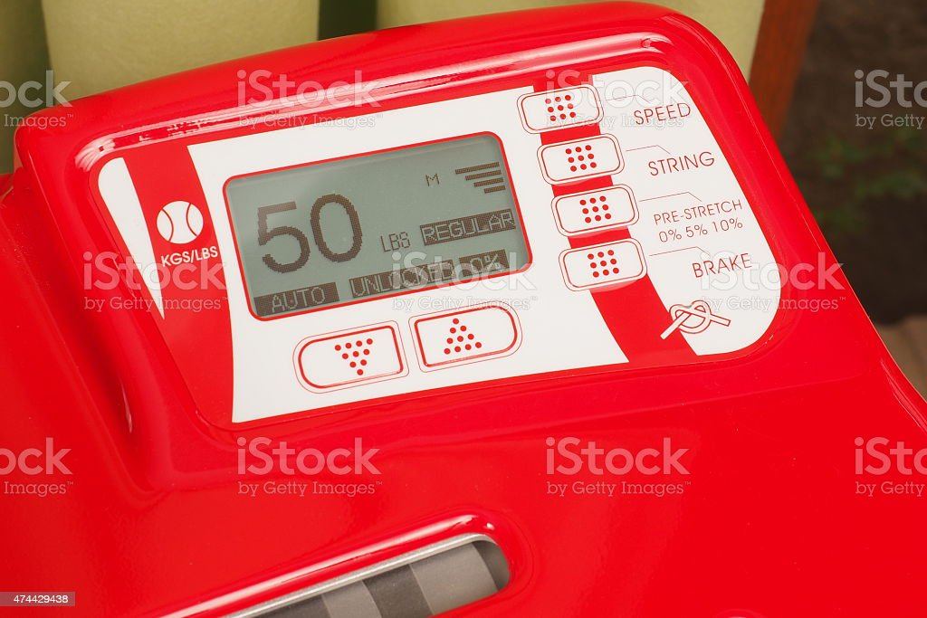 Electronic display and keyboard of a stringing machine stock photo