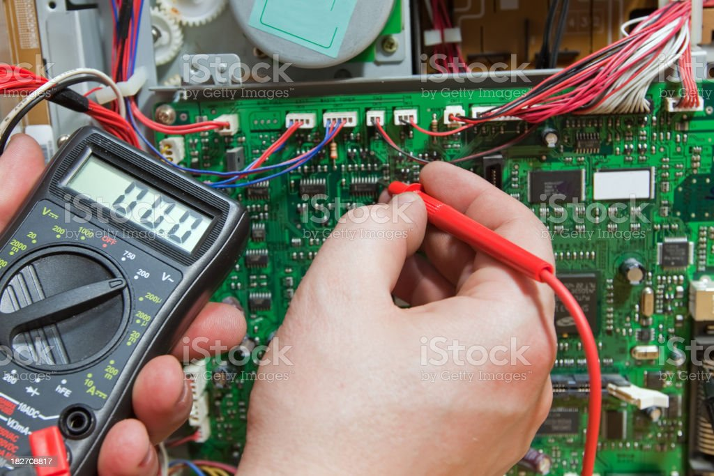 Electronic engineer measures the electronic circuits. stock photo
