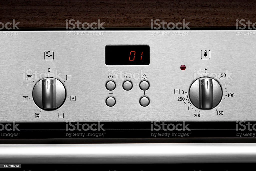 Electronic front panel of modern stainless steel kitchen oven stock photo
