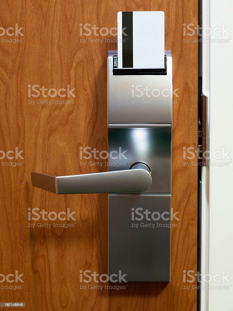 Electronic keycard in hotel door stock photo