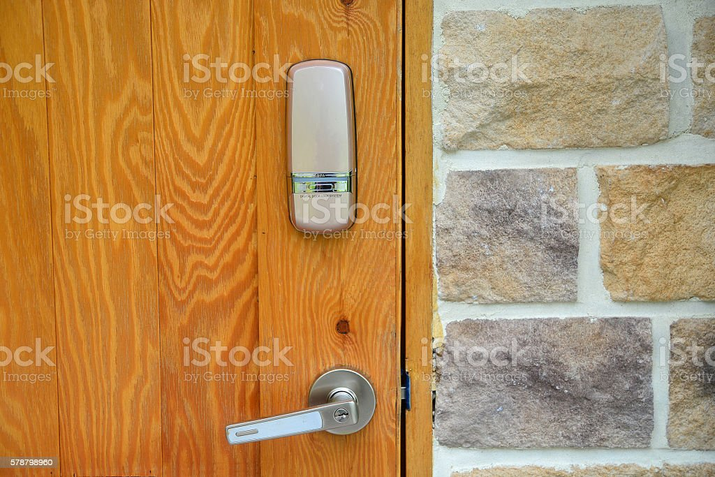 Electronic lock on wooden door stock photo