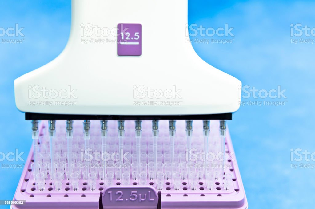 Electronic multichannel pipette and microtips for research and experiment stock photo