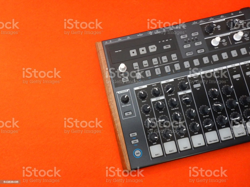 Electronic musical instrument or audio mixer or sound equalizer on a orange background (analog modular synthesizer) stock photo